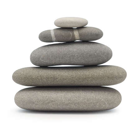 balancing stones isolated on white photo