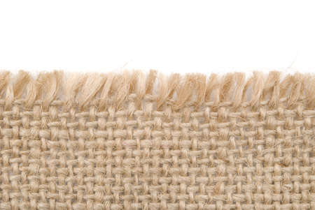 close up view of sackcloth material isolated on white photo