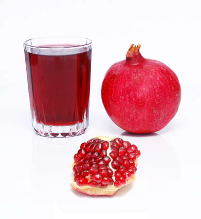 juce and pomegranate over white  photo