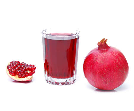 pomegranate juice and fruit over white photo