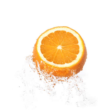 orange in water splash over white background photo