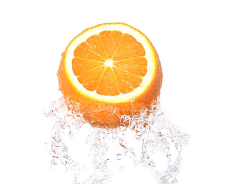 orange fruit in splash over white backgroung photo