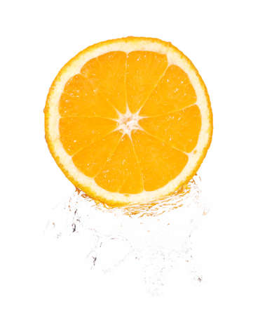 orange slice in splash over white background photo