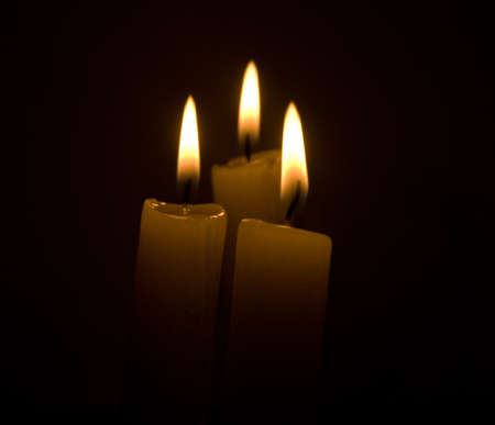candles over black background photo