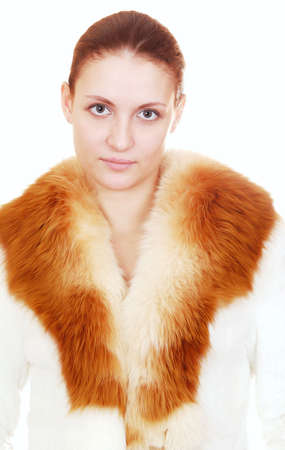 portrait of beautiful woman in fur coat over white Stock Photo - 4084082