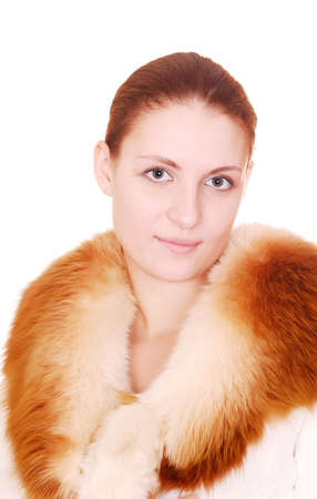 young beautiful woman in fur coat over white Stock Photo - 4084109