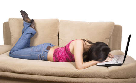 tired woman on sofa with notebook over white photo