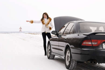 woman with her broken car photo