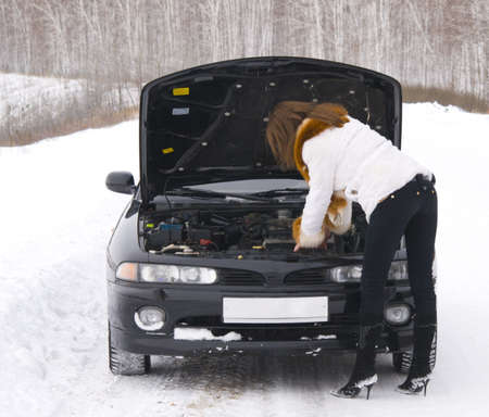 young woman with broken car Stock Photo