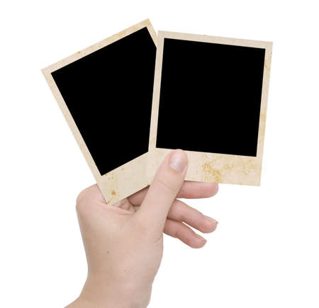 two photo frames on a hand over white photo