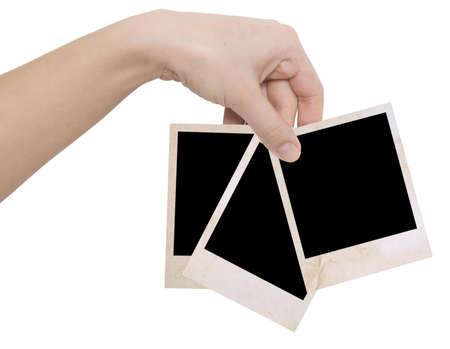 drei Bilderrahmen in der Hand auf einem weißen