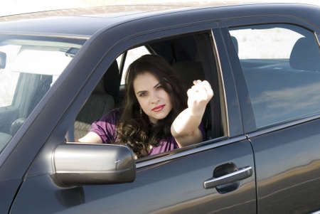 angry woman in her car photo