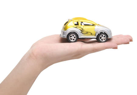 car on a hand over white background photo