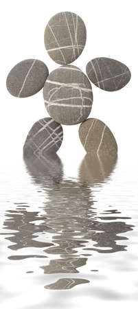 pebbles in the shape of the man reflected in water photo