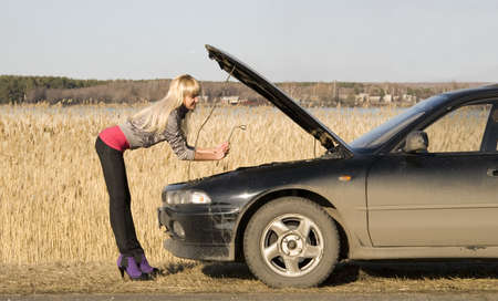 young pretty woman with her broken car Stock Photo - 4705491