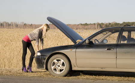 young pretty blonde with her broken car Stock Photo - 4705490