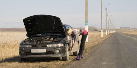 young pretty woman with her broken car Stock Photo - 4738144