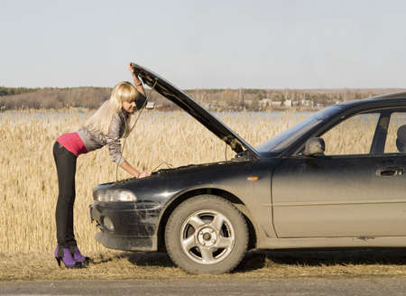young pretty woman with her broken car Stock Photo - 4738145