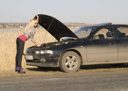 young pretty woman with her broken car Stock Photo - 4738143