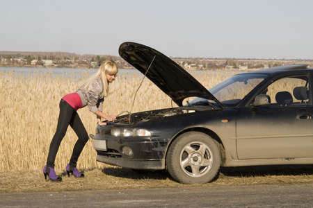 young pretty blonde with her broken car Stock Photo - 4782129