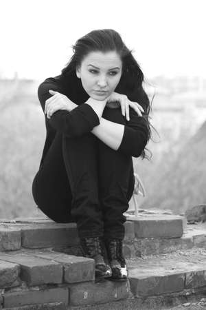 young pretty woman in a depressed state Stock Photo - 4797375