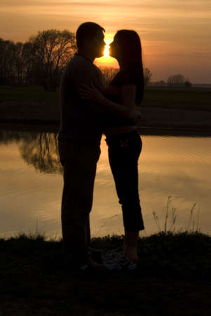 silhouette of a couple kissing on the beach Stock Photo - 4834891