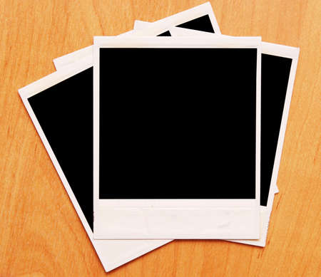 polaroids: polaroids frames on a wooden background