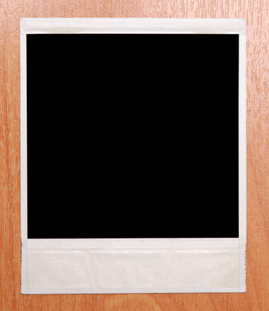polaroid frame isolated on a wooden background Stock Photo - 4903048