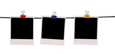 white polaroids: polaroids on a rope isolated on white Stock Photo