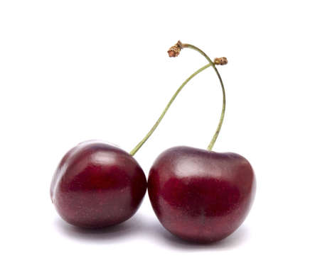 two cherries isolated on white background photo