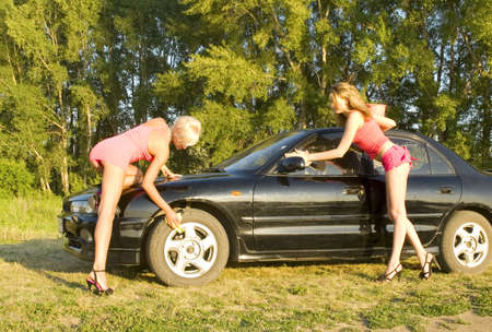 two young woman wash the car photo