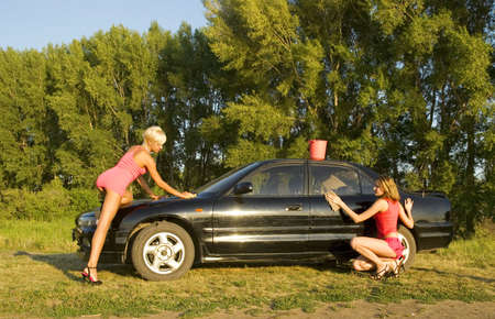 two woman washing the car photo