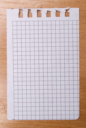 page from a notebook on wooden background photo