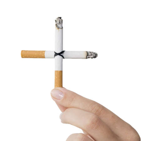 cigarette cross in a hand isolated on white Stock Photo - 5565315