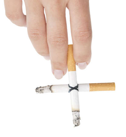 cigarette cross in a hand isolated on white photo