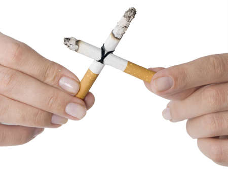 cigarette cross in a hand isolated on white Stock Photo - 5565493