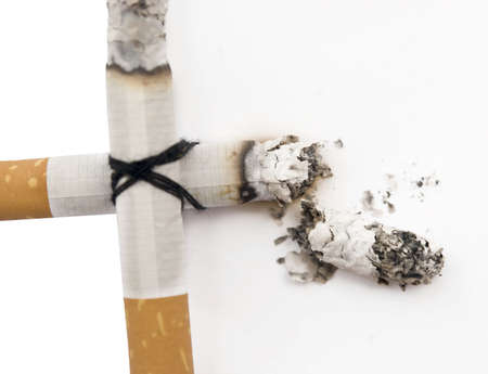 cigarette cross isolated on white Stock Photo - 5565494