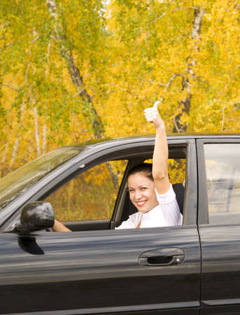 happy woman sitting in her car photo
