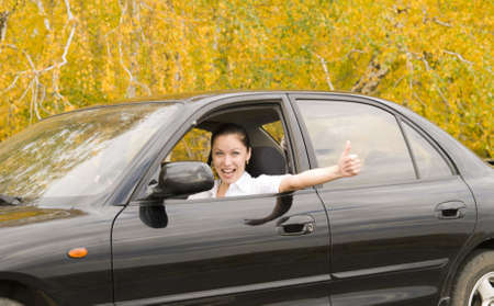 young happy woman in her car photo