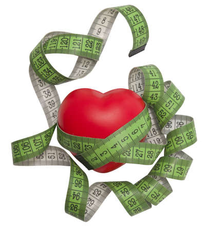 measurement tape: heart with green measurement tape Stock Photo