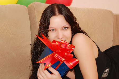 young pretty woman with gifts Stock Photo - 6053071