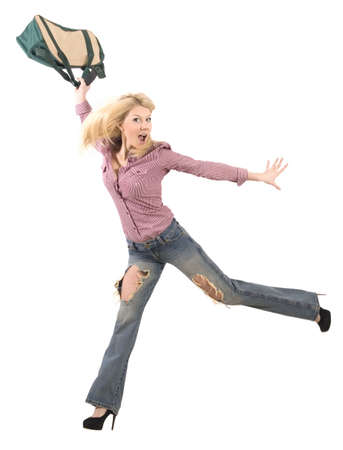 young jumping blonde with bag over white photo