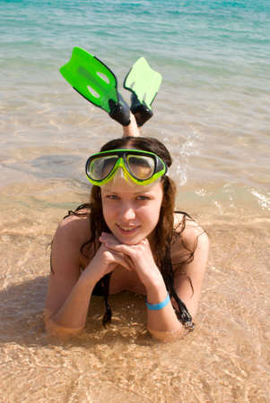 young pretty woman with swimming mask and flippers photo