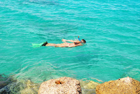 young girl snorkelling in the sea Stock Photo - 6597745