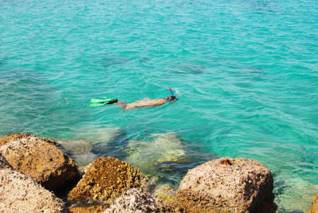 young girl snorkelling in the sea Stock Photo - 6630124
