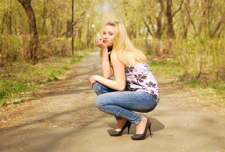 young pretty woman in a park photo