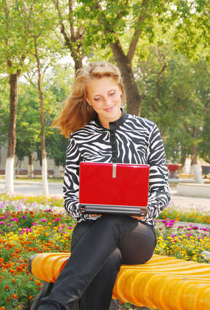 young pretty woman with laptop photo