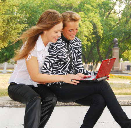 two young students  looking in laptop  photo