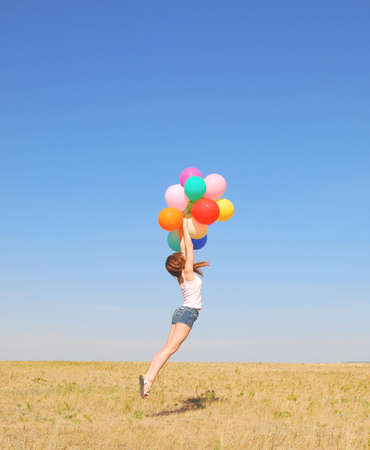 young jumping woman with balloons photo
