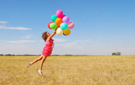 young jumping woman with balloons Stock Photo